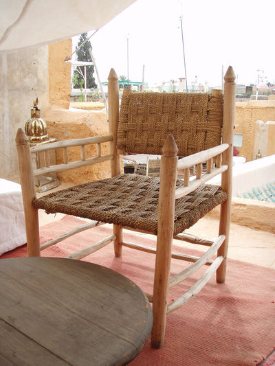 Adventure Africa Arid Climate Chair Fabric Marrakech Medina Morocco Natural Colors Peaceful Quiet Roof Rooftop Serene Sky Table Travel Warm Colors Wood