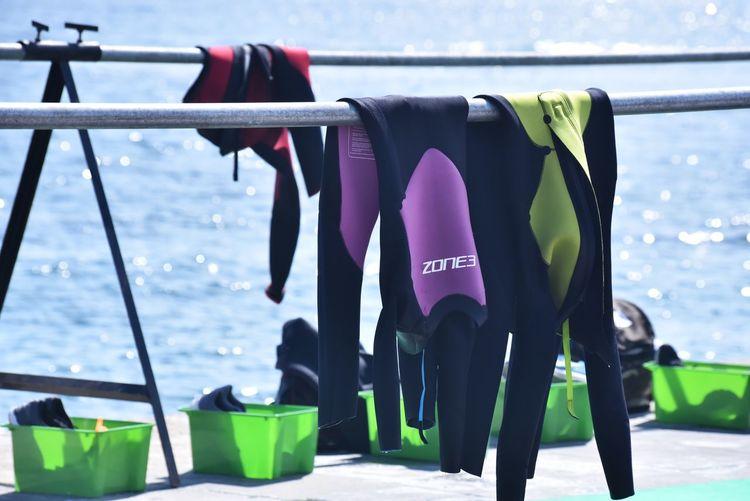 You just keep me hanging on... Eye4photography  EyeEm Gallery Sports Clothing Sports Photography Sports TRIATHLON Wetsuit Swimming athleisure Sport Still Life Sunny Day No People EyeEm Best Shots Water Hanging Sea Railing Close-up Clothesline Clothes Drying Cloth Outside Fabric