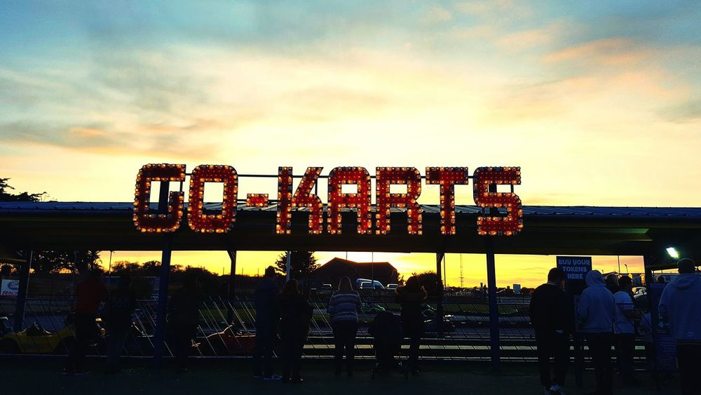 🏁🏎🏁 💕😊📸GO KARTS Landscapes With WhiteWall Go Kart Go Karting Funfair Amusementpark Sunset Taking Photos Clouds And Sky England Sky Here Belongs To Me Capture The Moment Landscape Silhouette Neon Sign Check This Out Eyem Best Shots Photography In Motion People People Watching Queue Capture Tomorrow