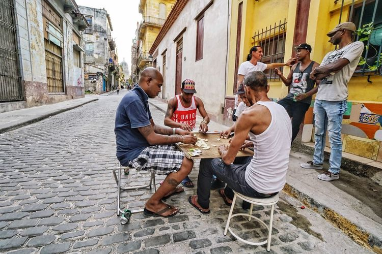 Game Play Men Street Cuba Habana Domino Dominoes Havana Building Exterior Architecture Built Structure City Street Men Real People Group Of People Sitting Leisure Activity Lifestyles Males  Day People