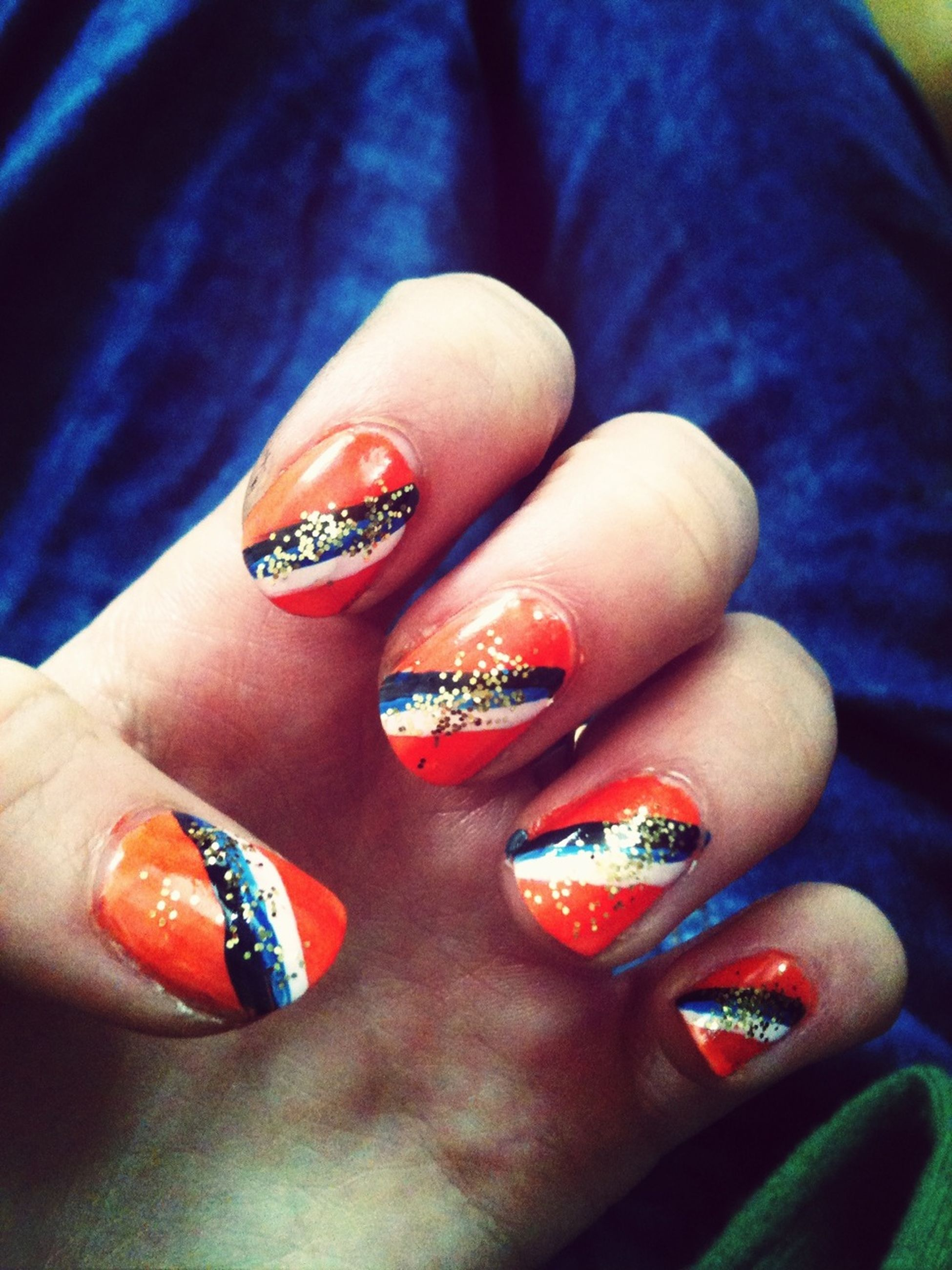 person, part of, close-up, human finger, indoors, holding, jewelry, ring, showing, cropped, unrecognizable person, fashion, high angle view, nail polish, creativity, lifestyles, multi colored