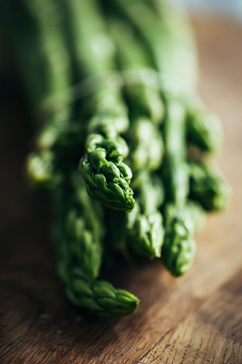 Green asparagus Asparagus Close-up Focus On Foreground Food Food And Drink Freshness Green Green Color Healthy Eating Indoors  No People Raw Food Selective Focus Still Life Studio Shot Table Vegetable Wellbeing Wood - Material