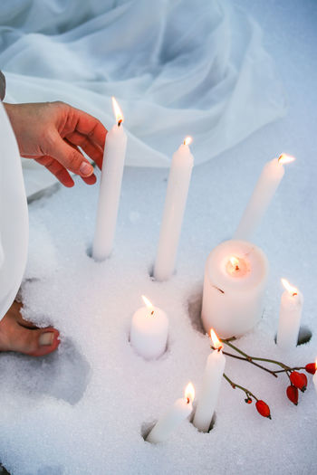Candles in the snow Candlemas Candles Light Light And Shadow Sky Winter Snowy Imbolc Hand Feet Body Part Human Body Part Candles In The Snow Celebration Celebrating Celebrating Life Real People Spirituality Nature Human Hand Flame Candle Fire Burning Holding One Person Finger Lifestyles
