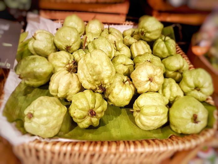 High angle view of guavas in basket for sale
