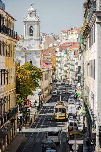 Church Colourful Perspective Portugal Road Tram Travel Travel Photography Architecture Building Exterior Built Structure City Daily Life Day Lifestyles Lisboa Lisbon Outdoors Road Street Streetphotography Tramway Transportation Travel Destinations Travelphotography