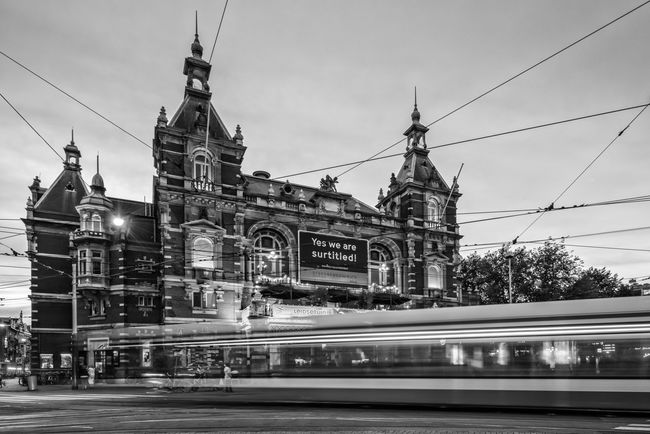 Totally Wired Amsterdam Architecture Black And White Blackandwhite Building Exterior Cable Capital Cities  City Dutch Famous Place History Landmark Leidseplein Long Exposure Low Angle View Monochrome Motion Movement Nederland Netherlands Outdoors Public Transport Road Transportation Travel Destinations