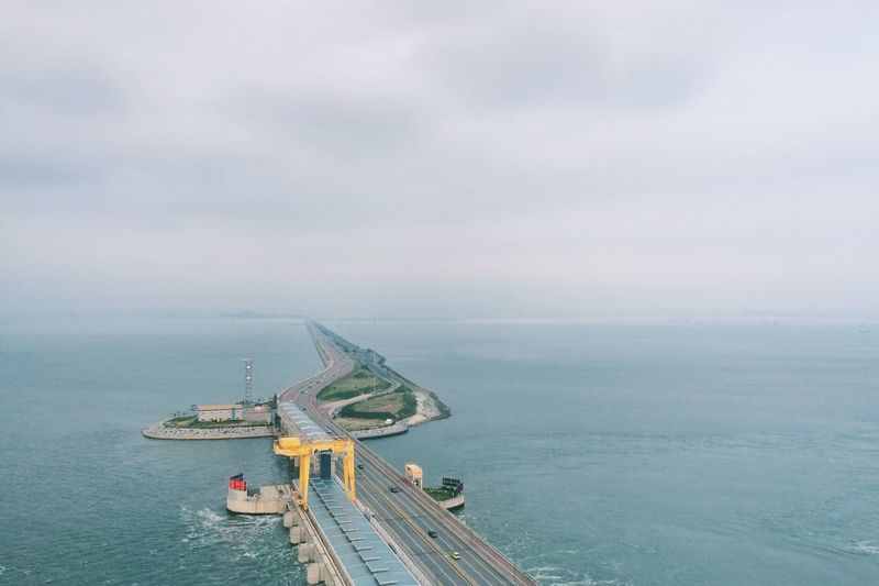 High Angle View Of Road Amidst Sea Against Sky