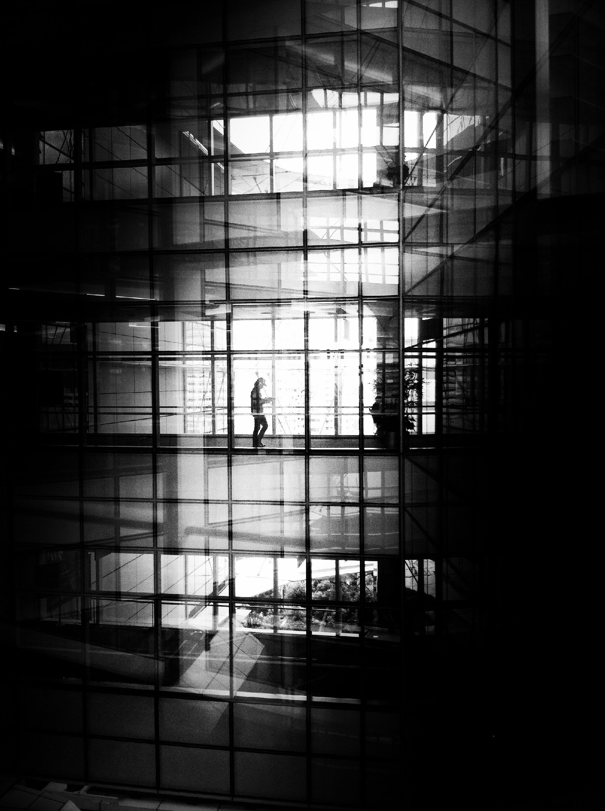 architecture, window, built structure, glass - material, building exterior, indoors, reflection, building, men, transparent, silhouette, city, modern, glass, walking, city life, unrecognizable person, day