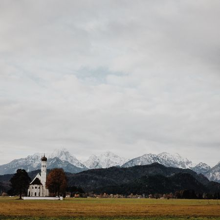 Church in front of the Bavarian alps at Hohenschwangau / Neuschwanstein Architecture Bavaria Bavarian Alps Bavarian Landscape Beauty In Nature Building Exterior Built Structure Cloud - Sky Day Hohenschwangau Mountain Mountain Range Nature Neuschwanstein NeuschwansteinCastle No People Outdoors Sky