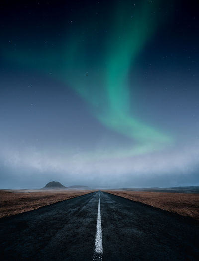 Road against sky at night