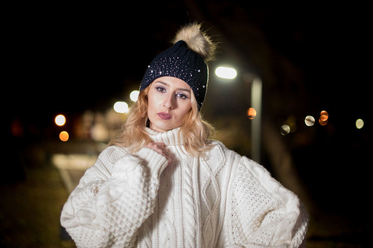 young woman outdoor in park Adult Adults Only Beautiful Woman Blond Hair Headshot Knit Hat Only Women Portrait Warm Clothing Winter Women Young Adult