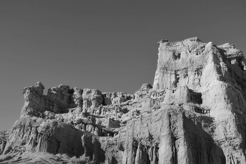 Black and white low angle landscape of vertical rock formations in Red Rock Canyon State Park in California Rock Formations Black And White California Red Rock Canyon State Park Travel Destinations EyeEm Selects Sky Nature Low Angle View Clear Sky Day Sunlight Mountain Copy Space Tranquility Rock Travel Outdoors No People