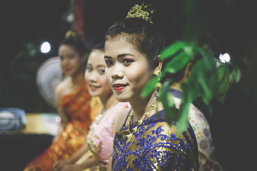 A young Thai woman rests after dancing a traditional dance Asian  Casual Clothing Close-up Cute Focus On Foreground Headshot Illuminated Leisure Activity Lifestyles Portrait Selective Focus Southeastasia Thai Thai Dance Thai Dress Thai Woman Thailand Traditional