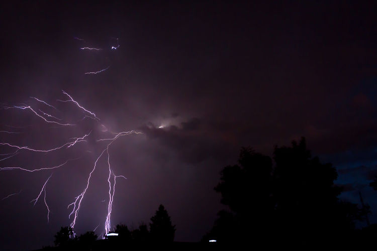 Beauty In Nature Cloud - Sky Dark Glowing Illuminated Light Lightening Lightening Strikes Lighteningstrikes Low Angle View Majestic Nature Night No People Outdoors Power In Nature Scenics Sky Storm Storm Cloud Stormy Weather Tranquil Scene Tranquility Tree Weather