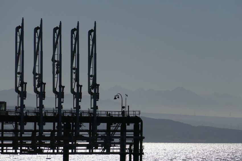 Gas Terminal Industrial Water Sea Sky Scenics - Nature No People Tranquil Scene Mountain Nature Tranquility Built Structure Pier Waterfront Mountain Range Outdoors Transportation Non-urban Scene