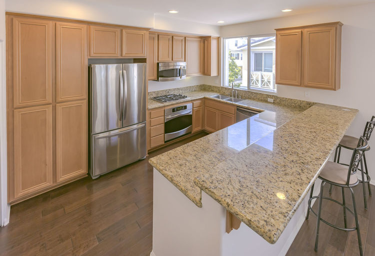 Appliance Architecture Cabinet Design Domestic Kitchen Domestic Room Faucet Flooring Hardwood Floor Home Interior Home Ownership Home Showcase Interior House Indoors  Kitchen Kitchen Counter Luxury Model Home Modern No People Oven Refrigerator Residential Building Stove Wood - Material