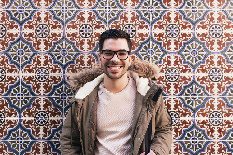 Young Adult One Person Front View Caucasian Man People Portrait Smart Phone person Communication Smiling Happy Fashion Handsome City Life Beard Glasses Street Lifestyle Happiness Copyspace Wall Looking At Camera Springtime Outdoors