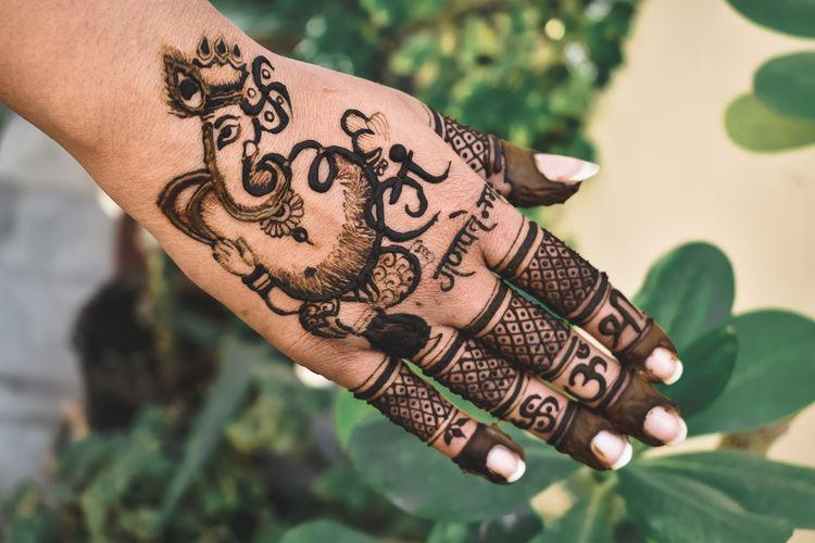 Close-up of mehndi design on human hand
