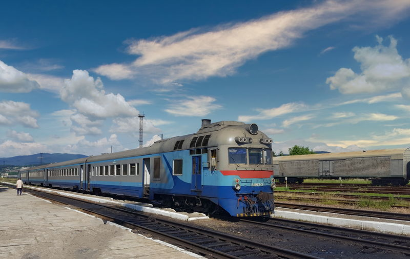 Train at railroad station against sky