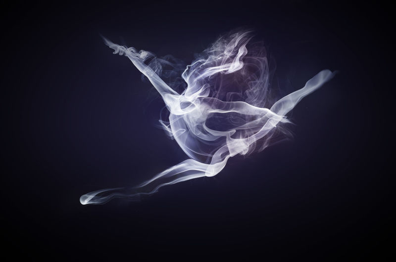 A picture of a smoke dancer made using individual smoke pictures that I took on a black background and warped in photoshop to look like a smoke dancer. Abstract Amazing Backgrounds Beautiful Black Background Check This Out Cool Dancer Effect Fragility Horizontal Instagood Light Mid-air Motion No People Person Photoshop Picoftheday Smoke Weed Studio Shot