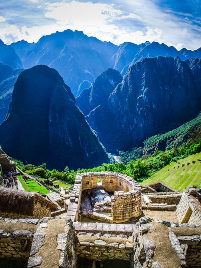 Sun temple in Machu Picchu overseeing mountain range Civilization Construction Inca Landscape Machu Picchu Mountain Range Outdoors Peru Ruins Scenics Sun Temple Travel Travel Destinations
