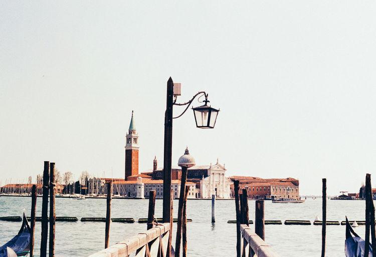 Wooden post in grand canal against church of san giorgio maggiore