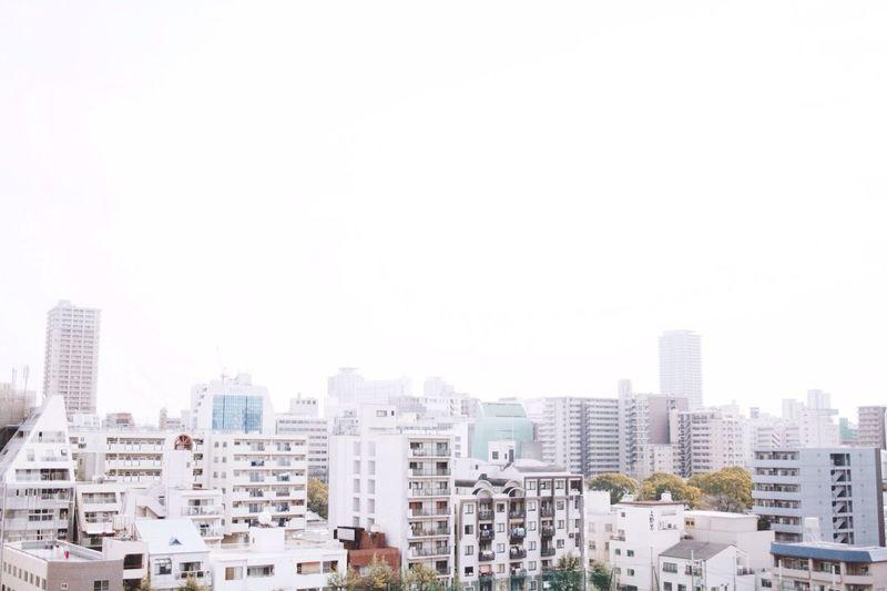 Buildings against clear sky