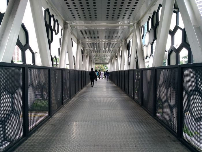 Light - Natural Phenomenon Street Art Street Photography Bridge Bridges Full Length Men Walking Architecture Built Structure vanishing point Diminishing Perspective The Way Forward Pathway Passageway Archway Hallway The Street Photographer - 2019 EyeEm Awards