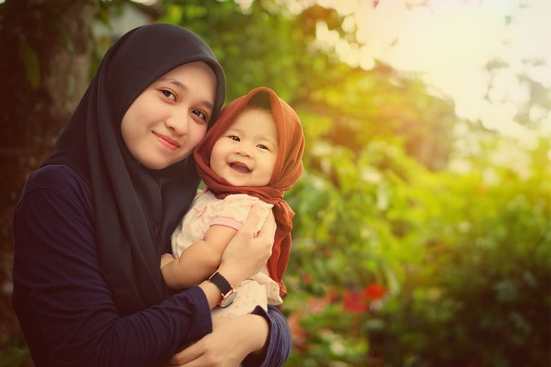 Baby Togetherness Child Love Embracing Mother Childhood Smiling Family With One Child Family People Holding Females Portrait Happiness Lifestyles Cute Carrying Family❤ Happy Outdoors Holiday Malaysia Malay Hijjab