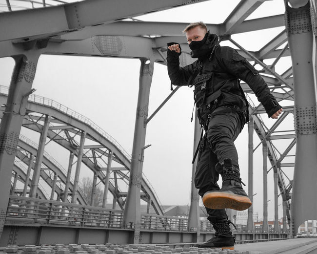 Urban Ninja, Urban, Urban Fashion, Fashion, ninja Real People Architecture Day One Person Full Length Bridge Built Structure Lifestyles Young Men Young Adult Bridge - Man Made Structure Men Connection Low Angle View Casual Clothing Clothing Transportation Sky Standing Outdoors