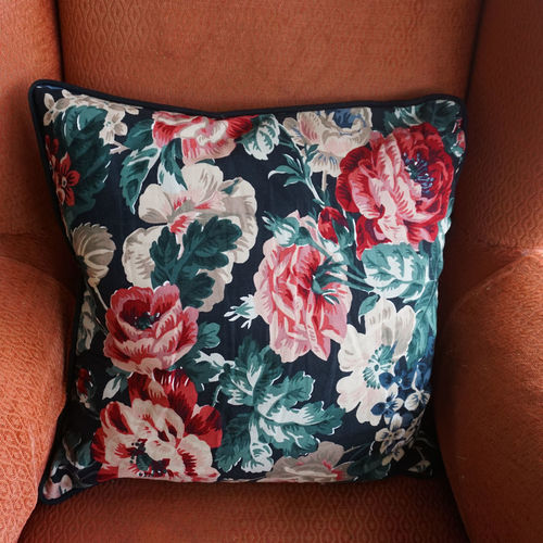 floral pattern cushion on coral colored old chair Coral Colored Pillow Cushion Floral Pattern Textile Fabric Chair Furnitures Square Shape Interior Home Home Interior Home Showcase Interior Interior Decorating Decoration Textile Close-up