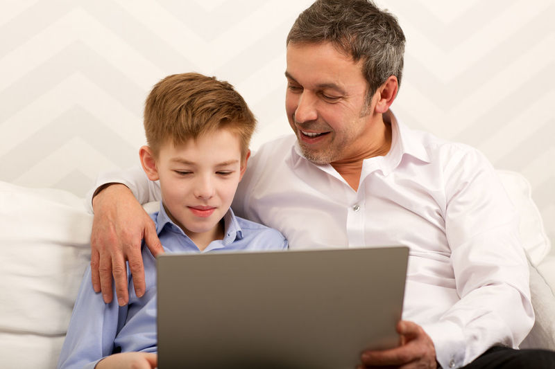Boy Caucasian Child Computer Dad Daddy Embrace Family Father Help Horizontal Kid Laptop Leisure Parent Parenthood Son Teenager Together Use Work