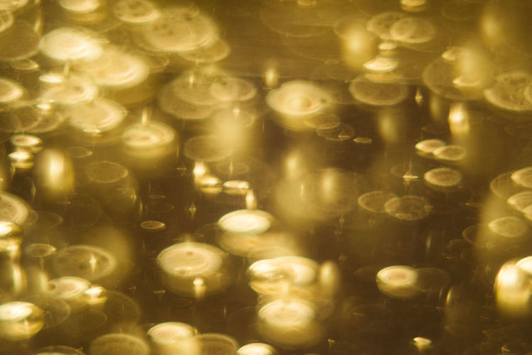 Textured  Texture Pattern Pattern, Texture, Shape And Form Gold Bubble Champagne Bubbles Drink Gold Colored Full Frame Backgrounds Close-up Christmas Lights Transparent Floating In Water Glass - Material
