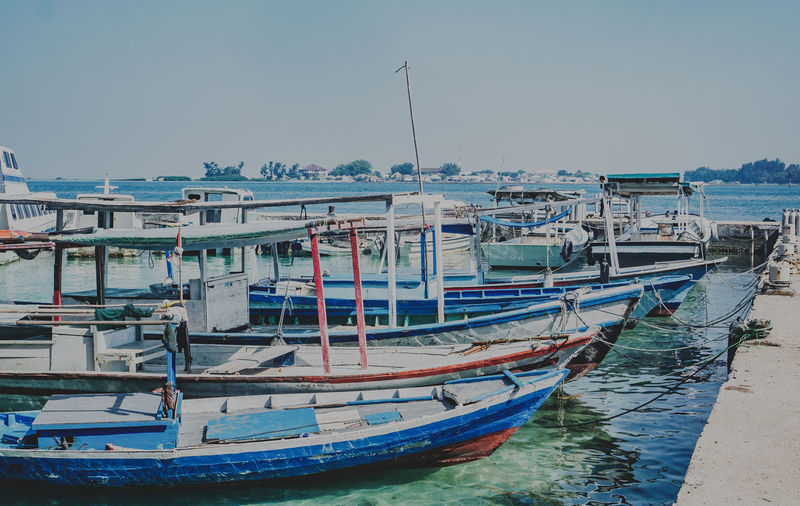 Lining up! Nautical Vessel Transportation Mode Of Transportation Moored Water Sky Nature Sea Harbor Day Clear Sky No People Architecture Outdoors Travel Waterfront Building Exterior Fishing Boat Blue Sailboat Fishing Industry Port INDONESIA Pramukaisland