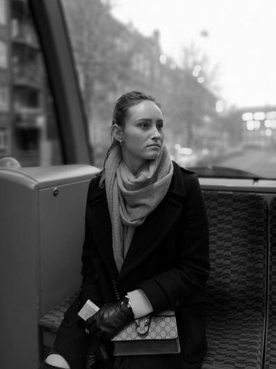 Portrait of a teenage girl looking away in winter