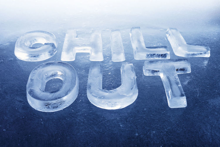 "Words ""Chill Out"" made of real ice letters on ice background."