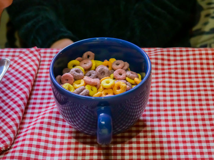 Cereal Breakfast Food Sweet Food Sweet Motion Stop Motion Motion Capture Dessert Temptation Indulgence Obesity Diabetes Diabetic Sugar Color Cereals American Cereal Cereals Snack Meal Morning Healthy Eating Lifestyles Still Life Round Shape Crunchy Nutrition Health Fruity Natural Flakes Corn Flakes Cornflakes Carbohydrate - Food Type Carbohydrates Childhood Calories Multicolors  Organic Mug Falling Down color palette Fruit Loops Loop Wellbeing Checked Pattern Food And Drink Tablecloth Freshness Bowl Table Kitchen Utensil Close-up Ready-to-eat Focus On Foreground High Angle View Eating Utensil Spoon Day Indoors  No People Red
