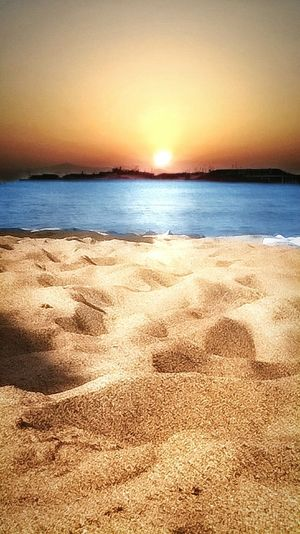 Beach Sand Sea Sunset Scenics Nature Tranquility Water Tranquil Scene Sky Horizon Over Water Outdoors Beauty In Nature Summer No People Backgrounds Landscape Vacations Sunlight Sun EyeEmNewHere