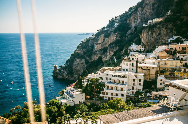 High Angle View Of Buildings And Rocky Mountains By Sea At Positano