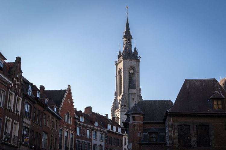 Belfry of Tournai, Belgium Tournai Wallonie Belgium Belgique Architecture Built Structure Sky Day Outdoors Building Exterior Building Tower City Clear Sky Place Of Worship Low Angle View Travel Destinations History The Past Travel Blue No People Spire  Location Clock Place