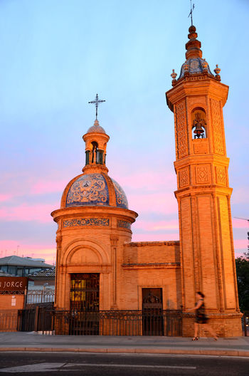 Sevilla, España Architecture Building Exterior Built Structure Cathedral Church Colorful Colours Crossing The Bridge Dome Famous Place Golden Hour History International Landmark Low Angle View Ornate Place Of Worship Religion Sevilla Sevilla, España Sky Spirituality Streetphotography Sunset Woman Walking Pastel Power