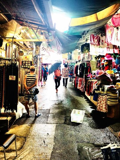 Stanley Market Path Streetphotography Urban Exploration HongKong Travel Destinations Real People Men City Walking Architecture Built Structure The Way Forward Retail  Direction Market Market Stall Incidental People Illuminated Street People Rear View Lifestyles #urbanana: The Urban Playground
