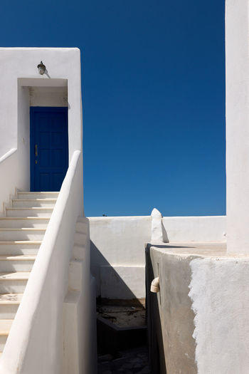Naxos Town Architecture Blue Building Building Exterior Built Structure Clear Sky Copy Space Day Low Angle View Nature No People Outdoors Railing Shadow Sky Sunlight Wall - Building Feature White Color Whitewashed Window