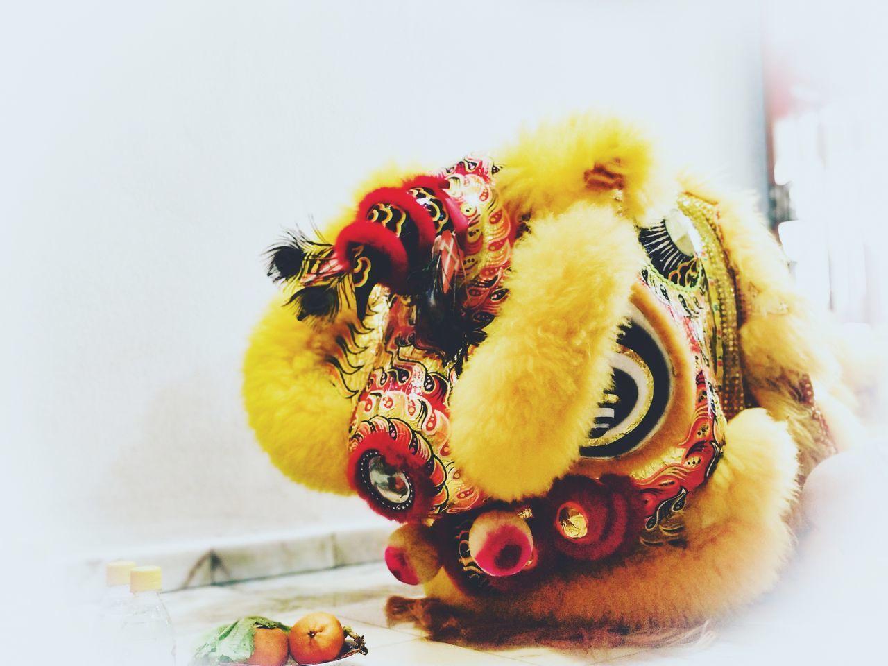 indoors, close-up, animal, animal themes, no people, toy, mammal, representation, animal representation, domestic animals, celebration, stuffed toy, one animal, decoration, holiday, pets, yellow, vertebrate, domestic