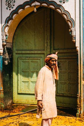 Man looking at entrance of building