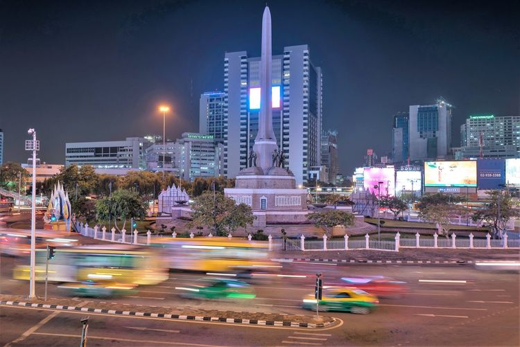 City Architecture Building Exterior Illuminated Motion Built Structure Night Blurred Motion Skyscraper Office Building Exterior Transportation Speed Long Exposure Mode Of Transportation Building City Life Light Trail Travel Destinations Cityscape Outdoors Bangkok Thailand. Travel Photography Victory Monument