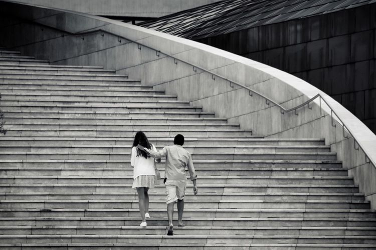 Couple walking on staircase