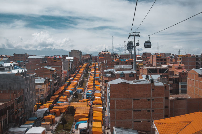 El Alto Views. Cable Car City Life El Alto La Paz Latin America Market Architecture Building Building Exterior Built Structure Cable Cityscape High Angle View Market Stall Mode Of Transportation Outdoors Residential District Roof South America Street Technology Transportation Travel Destinations Urban Urbex The Traveler - 2018 EyeEm Awards The Street Photographer - 2018 EyeEm Awards