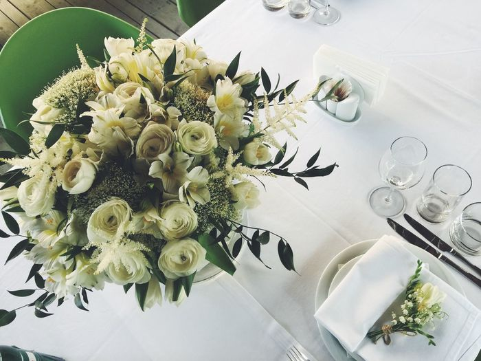 Directly above shot of roses in vase on dining table