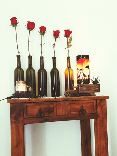 VisualHappiness Cariñitos Al Corazón Bottle No People Indoors  Day Old Pick Up Roses Cactus Collection Roses Are Red Candle Flame Candle Light Bottles On The Wall Wine Bottles African Lamp Lamp Lights In Decorations
